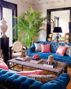 Blue sofa pink pillows