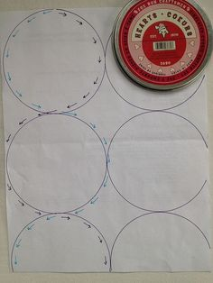 With a walking foot - starting at the top and making a figure 8 type pattern to quilt one side of the circle, then following across to quilt the other side of the circle below, as shown in this diagram. To get nice round circles, you want to make sure your circles are touching when you draw them on.