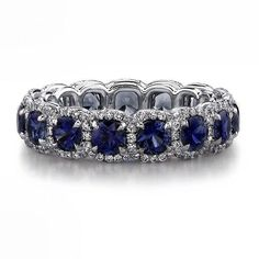 front view: #Sapphire and diamond #platinum eternity #wedding band handcrafted with 3.51 carats of #round #sapphires and 0.58 #carats of #brilliant #diamond rounds.