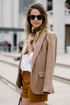 Chic street style with a blazer + shorts in autumnal colours & fabrics + a white shirt.