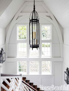 The staircase hall was inspired by the interior of a Pennsylvania Dutch barn.