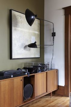 Serge Mouille lamp and retro hifi in teak cabinet. What's not to love. From tumblr blog The Black Workshop