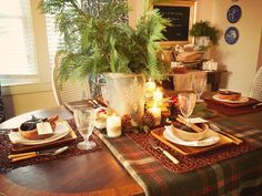Think Beyond the Linen Closet: Fold a vintage wool blanket and use it as a runner. It sets the color scheme and softens the warm wood of the table. christmas dinners, christmas table decorations, christmas tables, decorating ideas, christma tabl, christma decor, white christmas, tabl decor, rustic christmas