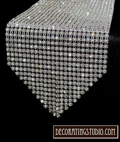 Rhinestone table runner bling.  Wouldn't this look great on the cake table!!
