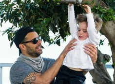 Hands-on dad Ricky Martin goofed around with his son at the park! Lovin' his modernized aviators, not to mention his chic springtime scarf!
