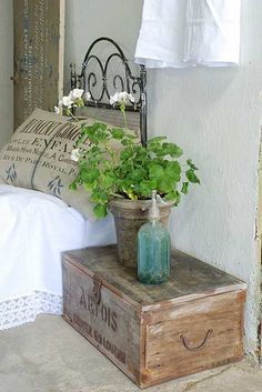 Love the grain sack styled pillow and crate side table