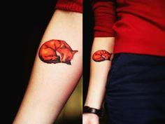 Sleeping fox tattoo