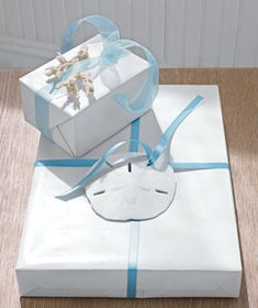 Beautiful idea for gift wrap! Prettier than bows :)
