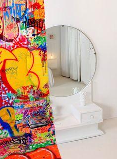 A French Hotel Room Half Covered in Graffiti interior design graffiti France