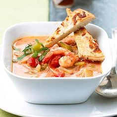 Whipping cream and tomatoes seasoned with herb and garlic make a rich base for this shrimp chowder main-dish recipe that can be prepared in less than 30 minutes.