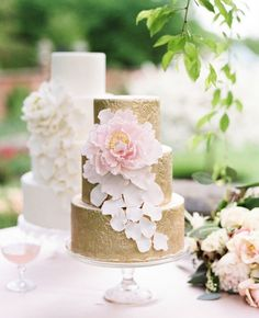 Gold wedding cake with sugar flower // Judy Pak Photography // http://blog.theknot.com/2013/09/05/glamorous-metallic-wedding-cakes/