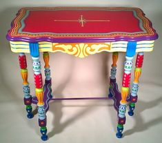 handpainted table by Lisa Frick