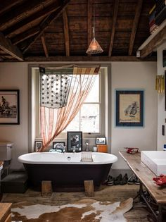 Great bathroom with tons of character and lots of great rustic, vintage decor