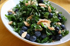 Blueberry, kale, and fennel salad w/ lemon-ginger dressing - serves 4; prep time: 15 mins; total time: 30 mins. Ingredients: 1 bunch kale, 3 tbsp lemon juice - juice of 1 lemon, 1 tsp honey, tsp grated fresh ginger, 6 tbsp EVOO, 1/2 funnel bulb - stalks and tough outer layer removed, 1/2 c fresh blueberries, 1/2 c almonds - toasted and roughly chopped, salt and pepper to taste.