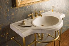 The Stone Forest Renaissance Console is distinguished by the sinuous, semi-circular projection of its basin. The traditional style entry, shown with a four-legged Palmer stand in an aged brass finish, is carved from blocks of Carrara or Calacatta marble.