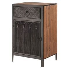 Bring rustic-chic appeal to your living room or master suite with this handsome wood and metal cabinet, showcasing an embossed finish and meshed detailing. JM ($176)