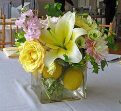 Fresh centerpiece  lemons, Lilies, Roses, Dahlias, Stock and Ranunculus