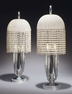 A pair of silvered-bronze table lamps made around 1925 by Émile-Jacques Ruhlmann (1879–1933). They were exhibited in 2004 at the Metropolitan Museum of Art's Ruhlmann retrospective.