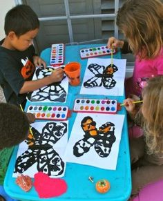 Painting Monarch Butterflies Craft- Kid World Citizen.  Use partial filled glue bottle to put black paint into.  Trace lines of one half of the butterfly with black glue, then fold paper in half. When dry you can fill the lines in with orange.