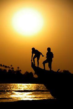 Playing At Sunset - Goa, India
