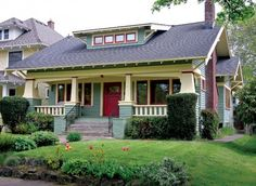 Craftsman-style bungalow features squat, battened porch posts and a ribbon of small dormer windows.