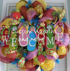 """Adorable tiki style welcome mesh wreath with flip flop sign, Hawaiian style wreath. yellow deco mesh, red burlap. pink mesh ribbon and green polka dot ribbon. wooden hawaiian flowers and palm trees! Perfect as a beach wreath, spring wreath, summer wreath welcome wreath, flip flop mesh wreath, pool wreath, outdoor wreath and more. Made on a 26"""" wreath all wired no hot glue"""
