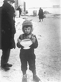 """In late 1943 the Nazis began to liquidate the ghetto, deporting many to concentration camps. In March 1944 the SS dragged all children under the age of 12 from homes and hiding paces. This so-called """"Children's Action"""" claimed 1300 lives. A mother's diary recorded the horror of watching her child """"tossed like a puppy into the truck...."""""""