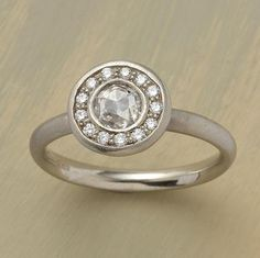 I'm not the biggest fan of most engagement rings but I love this one and have loved it since I first saw it in college almost ten years ago. ... maybe one day...