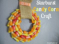 This Fabulous Starburst Candy Corn Wreath will definitely add a burst of warm colors to your fall decor. | AllFreeKidsCrafts.com