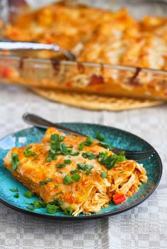 This sauce is killer! Pumpkin & Chicken Enchiladas Recipe | cookincanuck.com #chicken #enchiladas from @Mrs.Miller' Canuck | Dara Michalski