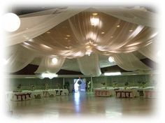 tulle wedding decorations ceiling, cheap and SOOOOO proud! Wrap white lights inside! Joanne's fabric sells!
