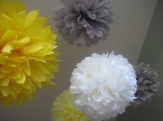 yellow and gray tissue paper pom poms