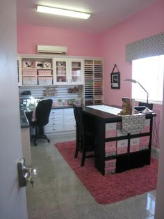 Simple craft space.  Instead of pink, I'd choose a bright green?  Like the idea of the slatboards under the upper cabinets.  Island table offers a nice working height since I like to stand.
