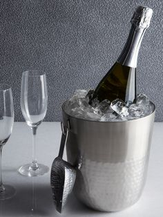 Cocktails: Make sure your champagne is kept well-chilled—keep several ice buckets like this one in cool hammered metal.