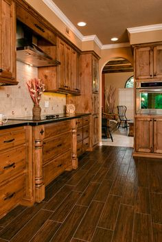 kitchen cabinets. Wonder if I can lighten up our cabinets to look like these?