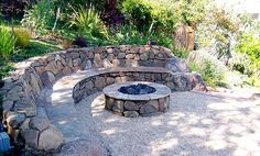 Hillside firepit w/  stone bench.  I love that the other side is bare, so you can cozy up a chair closer to the fire if the weather requires it.