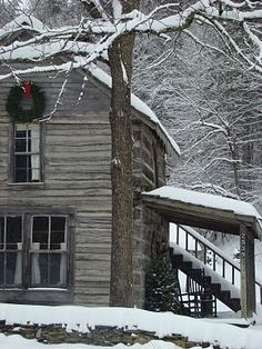 old house in the snowy woods