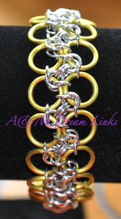 Modified Byzantine Bias Weave bracelet  made with Yellow Anodized and Silver Aluminum rings  7 1/2 inches