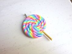 Rainbow Swirl Lollipop Charm. $3.75, via Etsy.