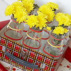Glass bottles as alternatee to galvanized tins for center pieces. I think the Starbucks frappecino bottles would be perfect for this.