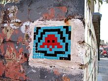 Invader Art. When visiting Paris look up the streets walls. Do you see the Space Invaders ?