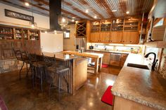 tin ceilings, industrial kitchens, rustic kitchens, stained concrete, modern kitchens