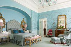 A garden motif enlivens the master bedroom.