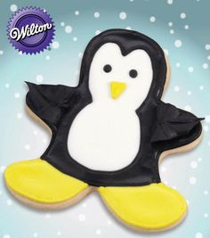 Make these cute penguin cookies from @Wilton Cake Decorating Cake Decorating Cake Decorating for a holiday treat!