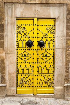 Yellow door in Tunisia (by khowaga1, via Flickr)