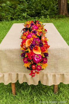 Don't limit your fall decor to rusty red and burnt oranges, add pops of orchid for a fresh new take on table landscapes. (Fall decor sold in-stores only.)