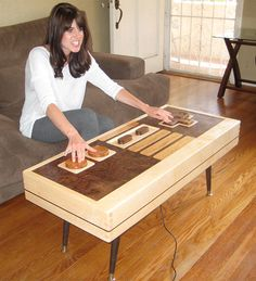 Awesome Nintendo controller coffee table, that actually works! My boyfriend would love this