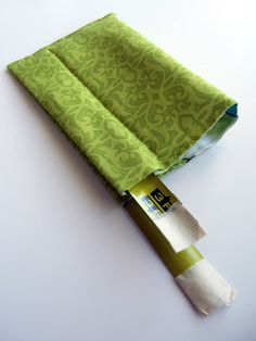 Just Another Hang Up: Snappy Bag Tutorial  --  Excellent tutorial with *lots* of pictures of how to make a Snap Bag with fabric scraps and an old broken metal tape measure.