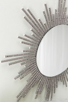 Paper straws were made for more than just drinking! All it took to create this starburst mirror was some creativity, glue, and an eye for DIY glamour!
