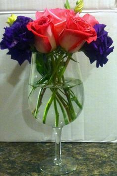 Wine glass centerpiece... Great for showers & rehearsal dinners!